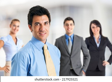 Portrait of a smiling businessman in front of his team