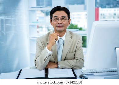 Portrait of a smiling businessman in his office