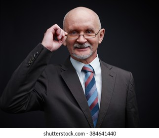 Portrait of smiling businessman looking at camera