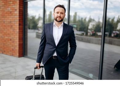 Portrait of smiling businessman outside