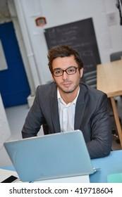 Portrait of smiling Businessman posing  in modern office