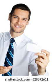 Portrait of smiling businessman showing blank business card, isolated on white background. Success in business, job and education concept shot.