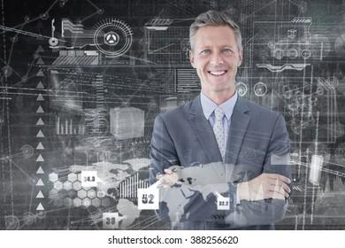 Portrait of smiling businessman standing hands folded against hologram background