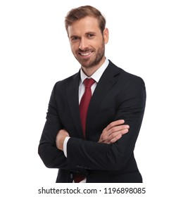 portrait of smiling businessman standing on white background with hands folded