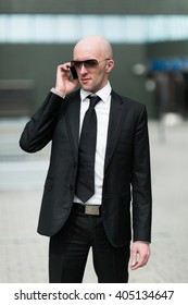 Portrait of smiling businessman talking on the phone.