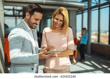 Portrait of a smiling businesspeople using digital tablet in the office.