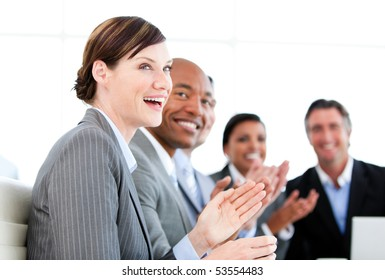 Portrait of smiling businessteam applauding a presentation against a white background
