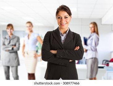 Portrait of a smiling businesswoman in front of her team