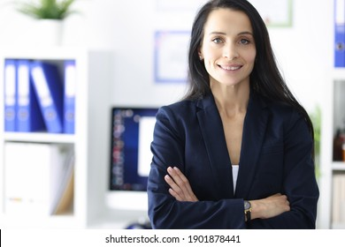 Portrait of smiling businesswoman in her office. Business partners and commercial proposals concept