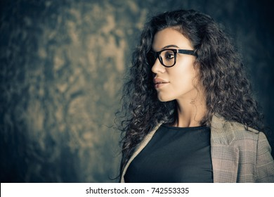 Portrait of a smiling businesswoman wearing glasses.