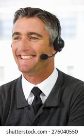 Portrait of smiling call center operator.