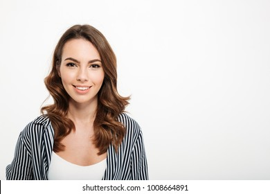 Portrait of a smiling casual girl looking at camera with copy space isolated over white background