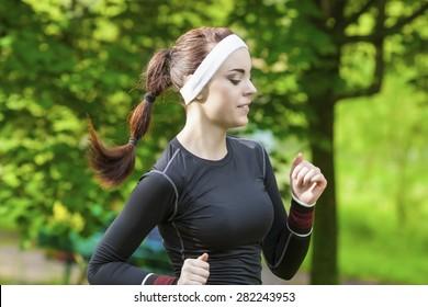 Portrait of Smiling Caucasian Sportswoman Having Her Regular Training Outdoors. Horizontal Image Orientation