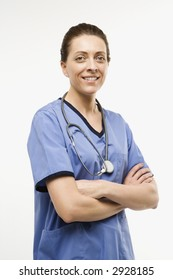 Portrait of smiling Caucasian woman doctor standing against white background.