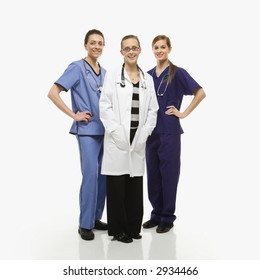 Portrait of smiling Caucasian women medical healthcare workers in uniforms standing against white background.