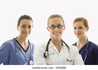 Portrait of smiling Caucasian women medical healthcare workers in uniforms against white background.