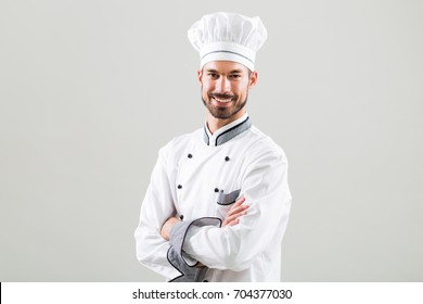 Portrait of smiling chef on gray background.Satisfied chef