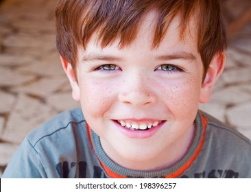 Portrait of a smiling child with freckles