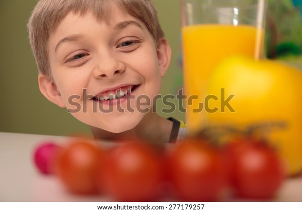 Portrait of smiling child with fresh healthy food