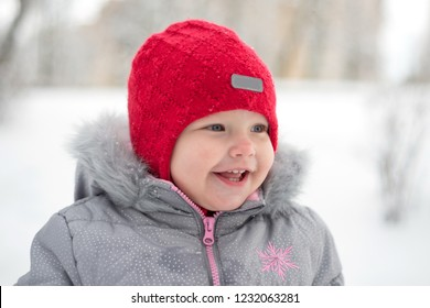 Portrait of a smiling child in the winter in the park