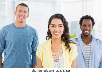 Portrait of smiling colleagues looking at camera in the office