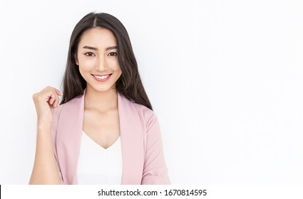 Portrait of smiling confident asian business woman in pink suit office. Asian business girl. Startup successful power business leader executive people looking camera with copy space isolated on white