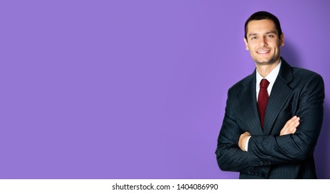 Portrait of smiling confident businessman in black suit and red tie, with crossed arms pose, empty copy space place for some text, advertising or slogan, against violet color background