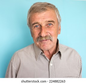 Portrait of a smiling and confident elderly good looking business man