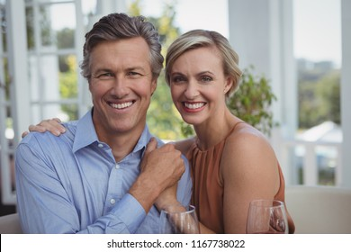 Portrait of smiling couple enjoying together in restaurant