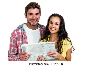 Portrait of smiling couple holding map on white screen