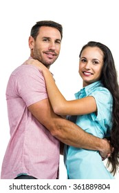 Portrait of smiling couple hugging on white background