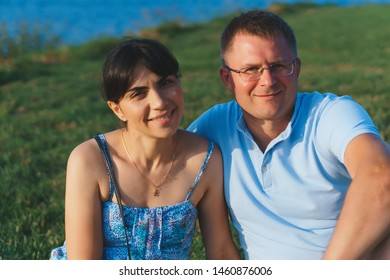 portrait of smiling couple in sunset light