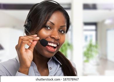 Portrait of a smiling customer representative at work