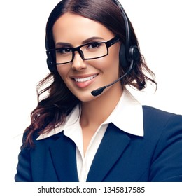 Portrait of smiling customer support phone operator in glasses and blue confident suit, isolated against white background