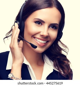 Portrait of smiling customer support phone operator