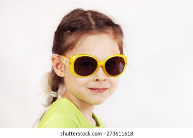 Portrait of a smiling cute little girl with sunglasses