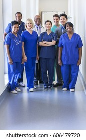 Portrait of smiling dedicated multi ethnic male female clinical nursing and management team in medical centre
