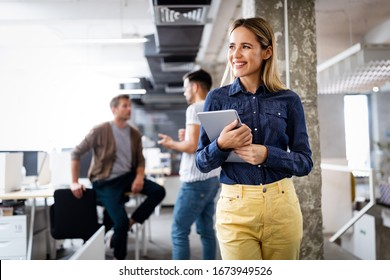 Portrait of a smiling designer, student, freelancer business woman using tablet computer