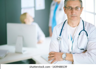 Portrait of a smiling doctor in his bright office