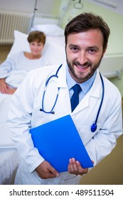 Portrait of smiling doctor holding a medical report in hospital
