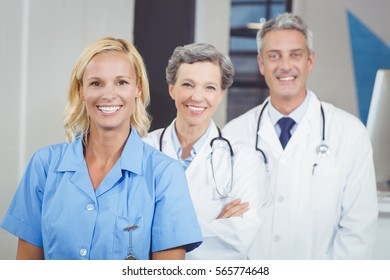 Portrait of smiling doctor team standing in hospital