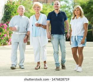 Portrait of smiling elderly friends walking outdoor
