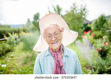 portrait of a smiling elderly lady in the garden