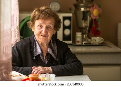 Portrait of a smiling elderly woman.