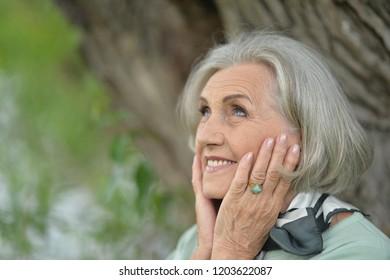 Portrait of a smiling elderly woman posing