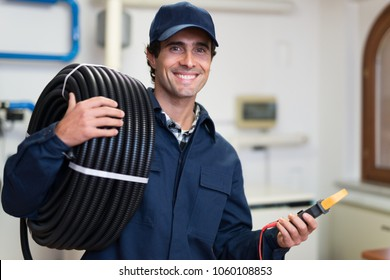 Portrait of a smiling electrician at work