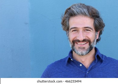 Portrait of smiling elegant mature man with copy space