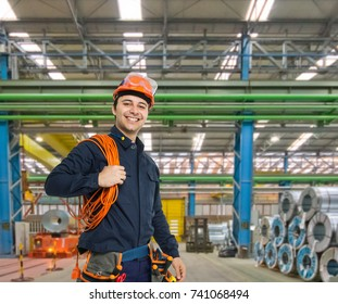Portrait of a smiling engineer in a factory