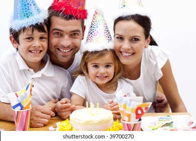 Portrait of smiling family celebrating son's birthday