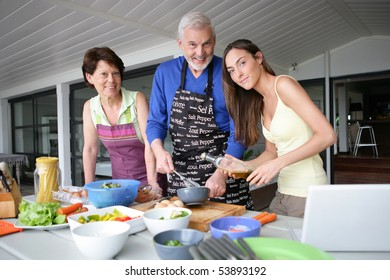 Portrait of a smiling family cooking
